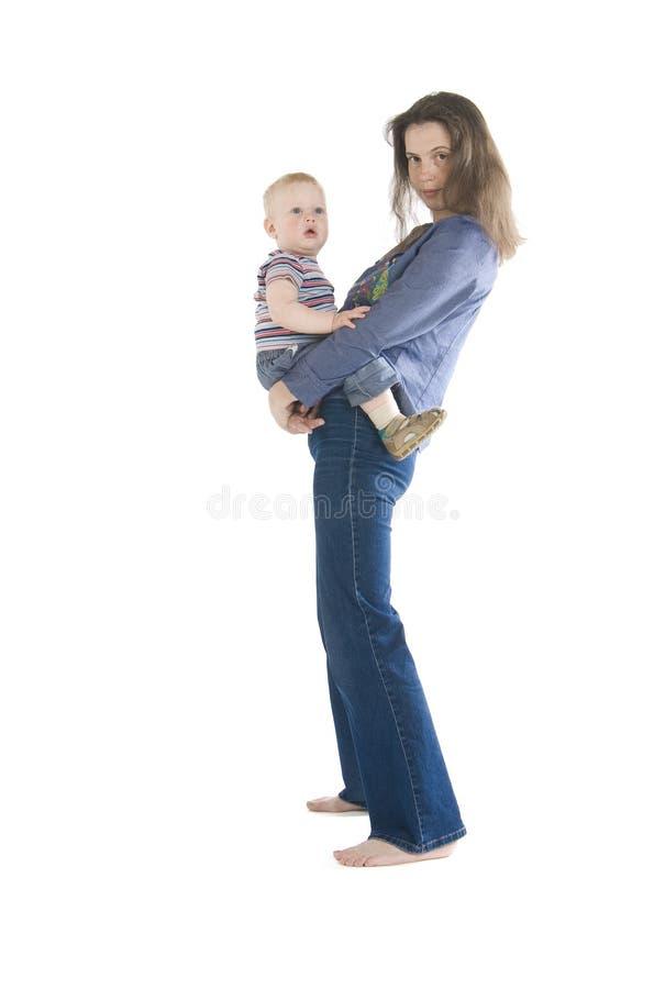 现有量拿着母亲儿子 库存照片