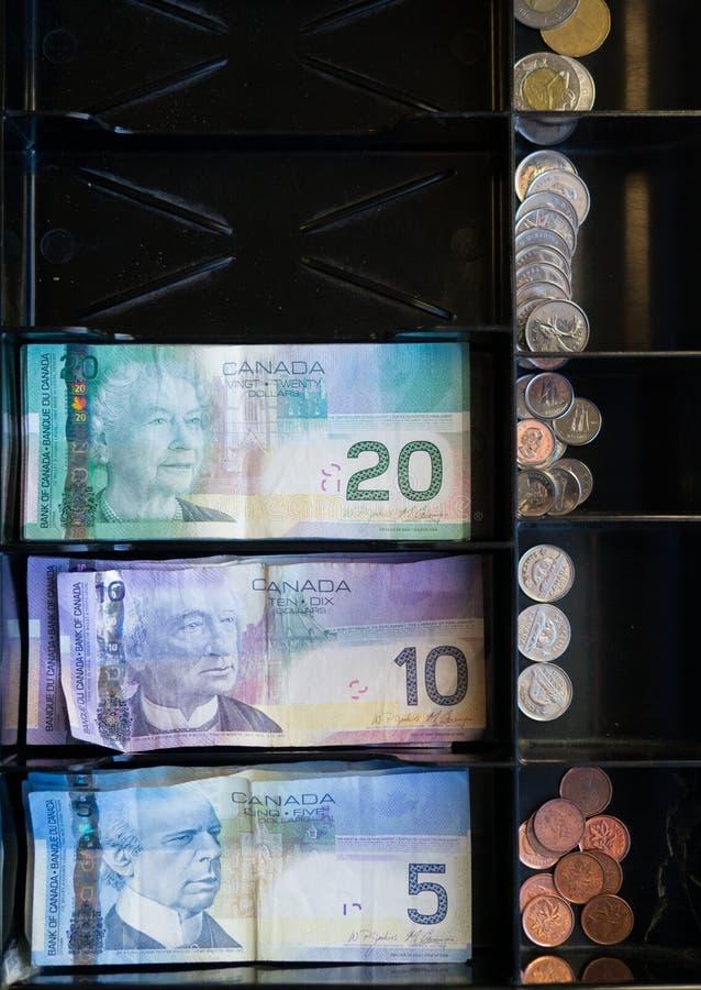 现金配件箱出票人加拿大货币 免版税库存照片