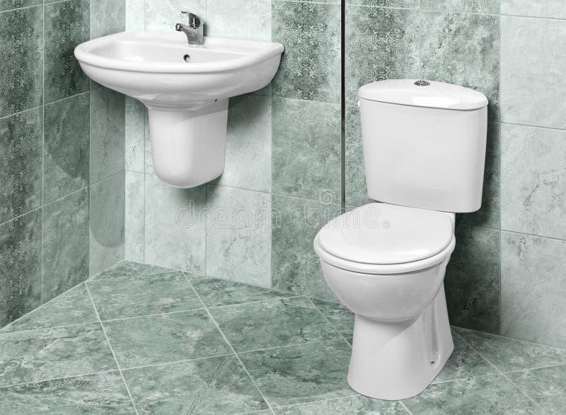 现代卫生间内部的细节在绿色大理石的 免版税库存图片