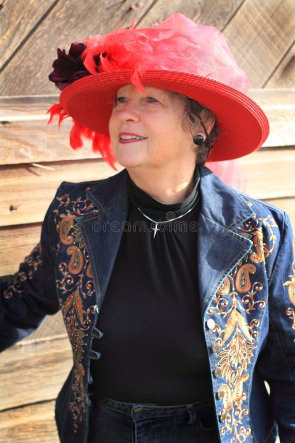 现代红色帽子女牛仔 库存图片