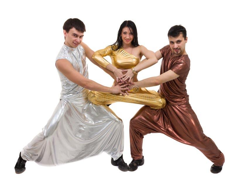 现代舞蹈家队跳舞,隔绝在全长的白色 免版税库存图片