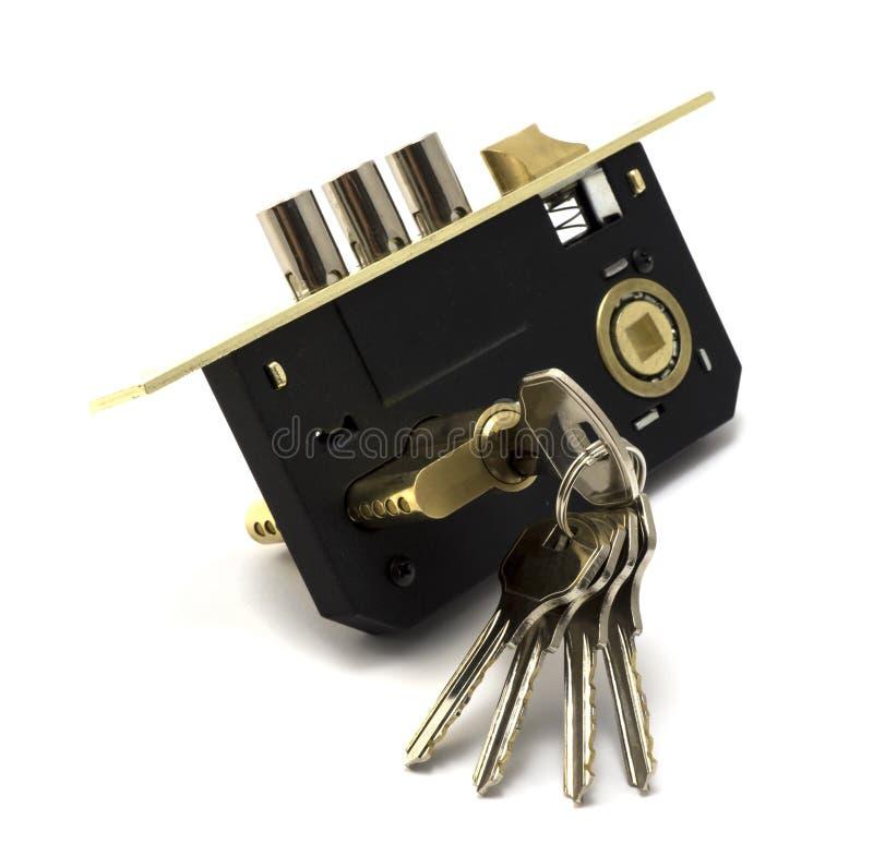 现代金子和黑锁有钥匙串的 免版税库存图片