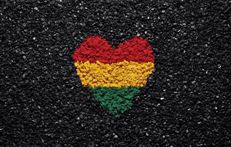 玻利维亚的旗子,玻利维亚的旗子、心脏在黑背景,石头、石渣和木瓦,墙纸 免版税库存照片