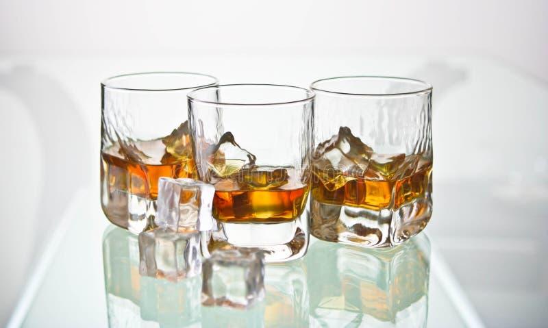 玻璃三威士忌酒 免版税库存图片