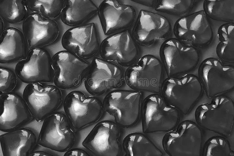 玻璃灰色心脏纹理在灰色背景的 免版税图库摄影