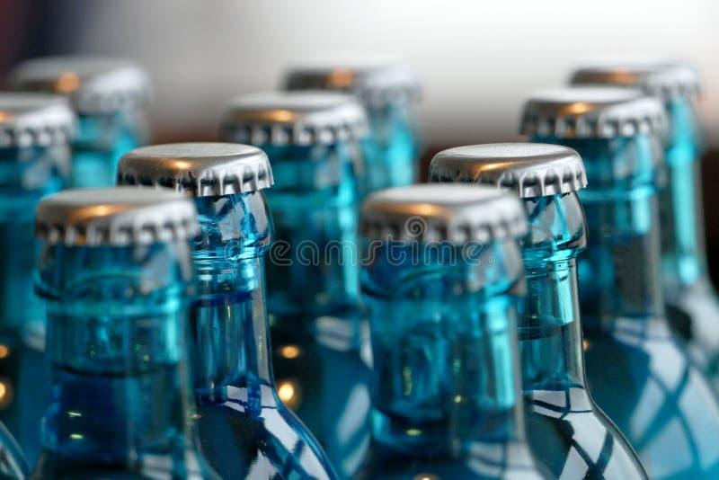 玻璃瓶在桌上的水 免版税图库摄影