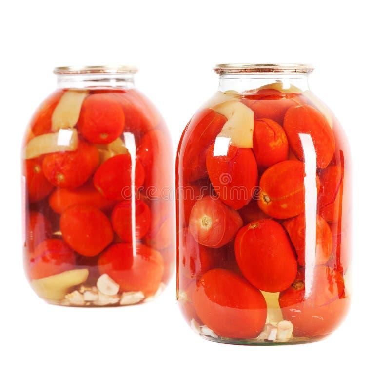 玻璃瓶子红色蕃茄 免版税库存照片