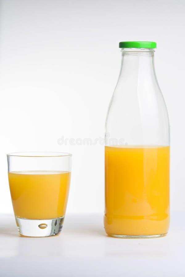 玻璃瓶汁液桔子 免版税图库摄影