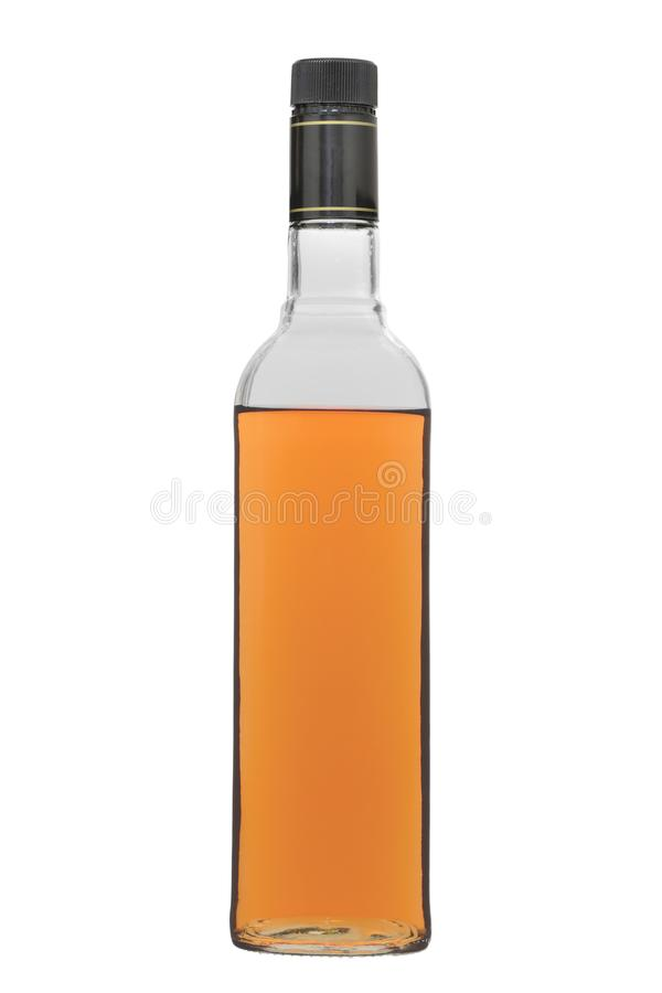 玻璃瓶用一片棕色树荫的酒精饮料在白色背景填装了,当停止者,被隔绝 免版税库存照片