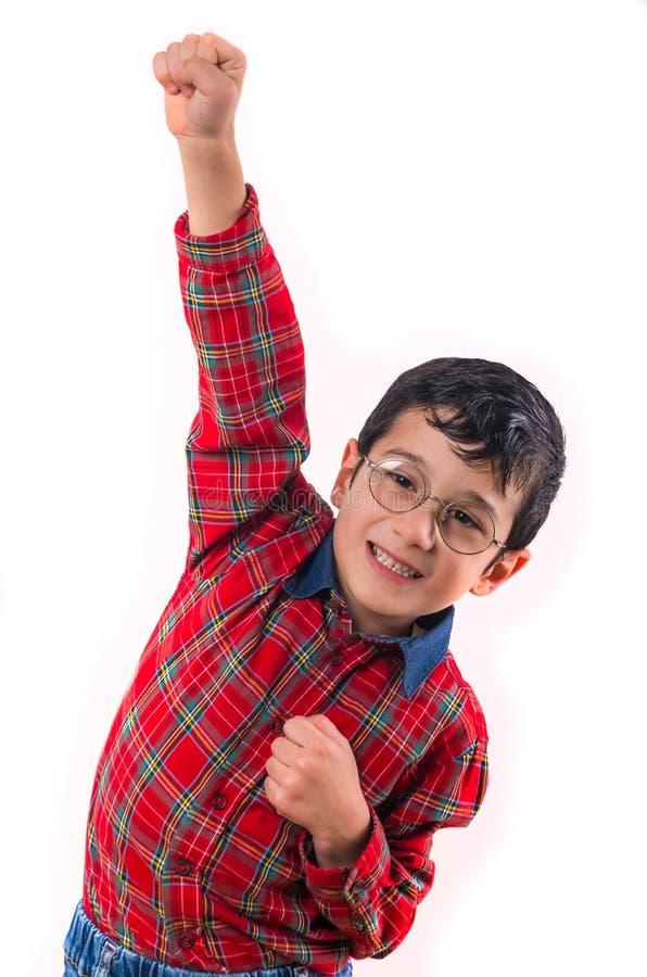 玻璃的小男孩举了他的手  隔绝在白色bac 库存图片