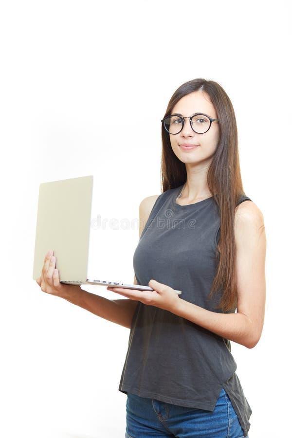 玻璃的画象微笑的年轻女商人被隔绝在白色背景 免版税库存照片