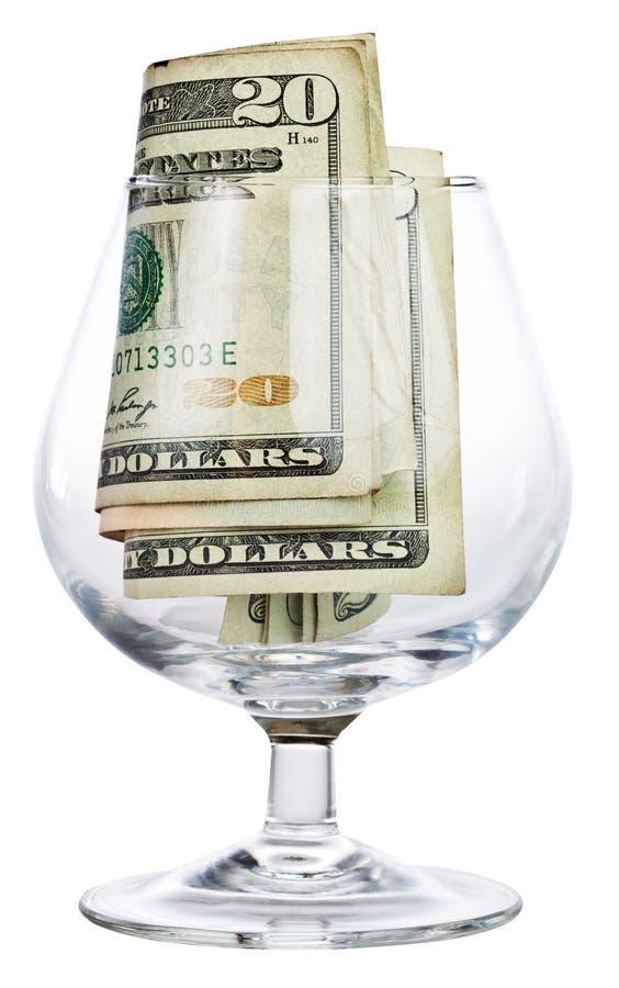 玻璃货币打翻酒 免版税库存照片