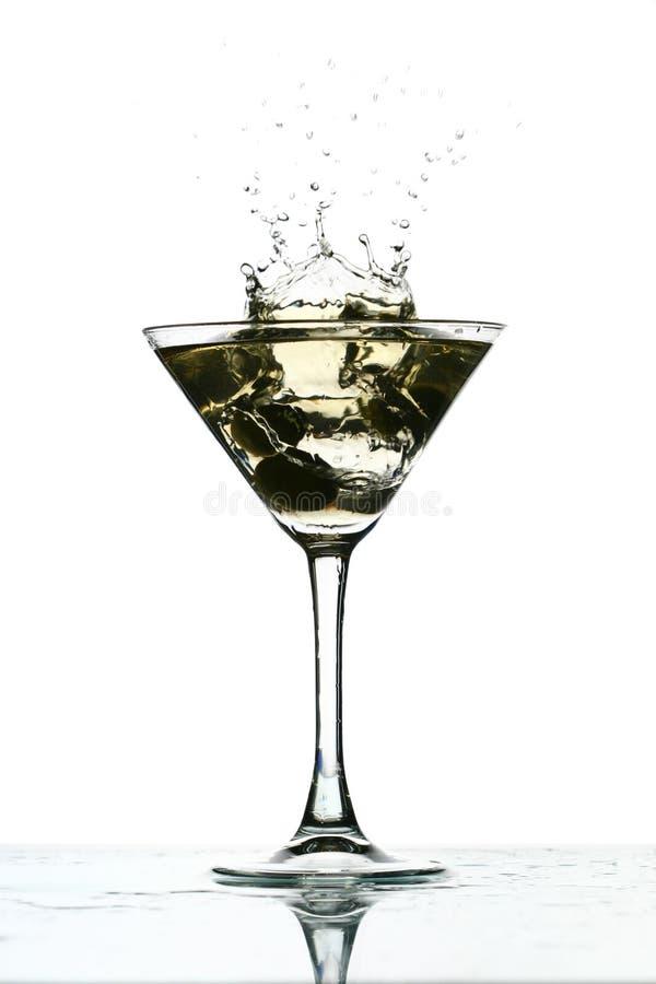 玻璃马蒂尼鸡尾酒飞溅 免版税库存照片