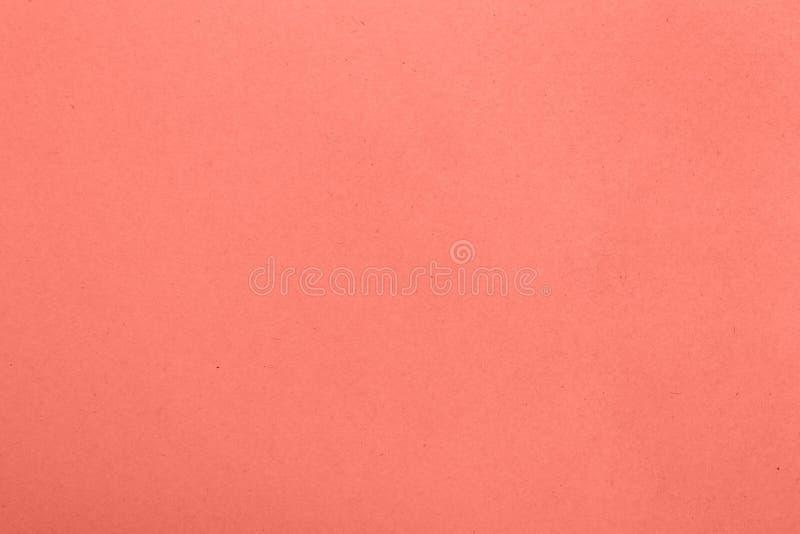 珊瑚桃红色被定调子的纸羊皮纸背景 免版税库存照片