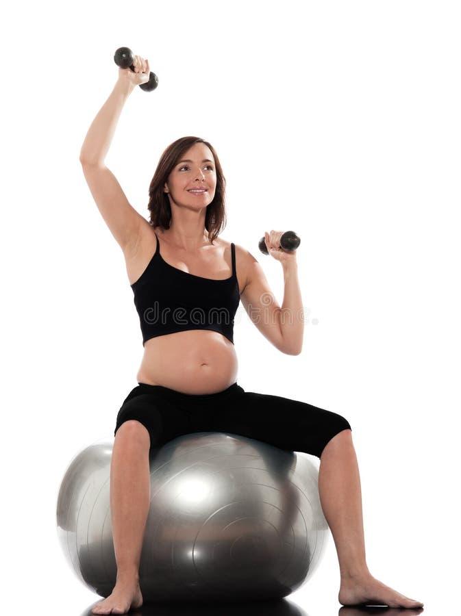球健身怀孕的坐的培训妇女 图库摄影