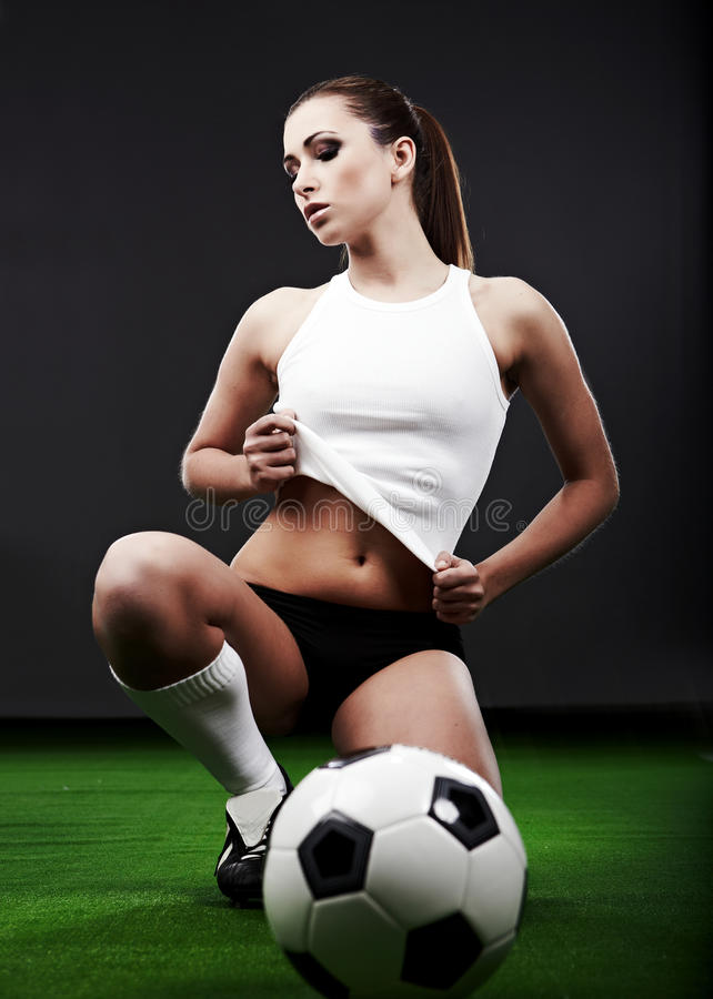 球员性感的足球 免版税库存图片