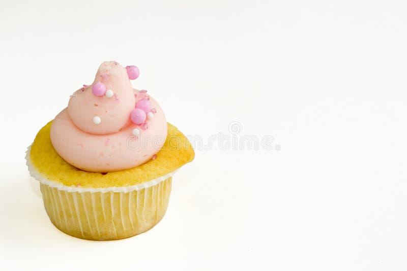 球杯形蛋糕结霜的桃红色糖 图库摄影