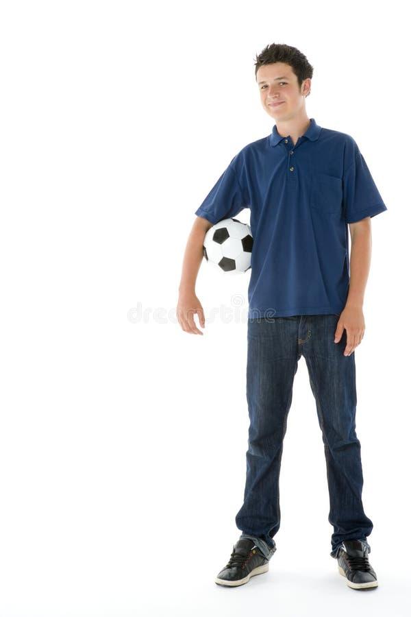 球童少年纵向的足球 库存照片