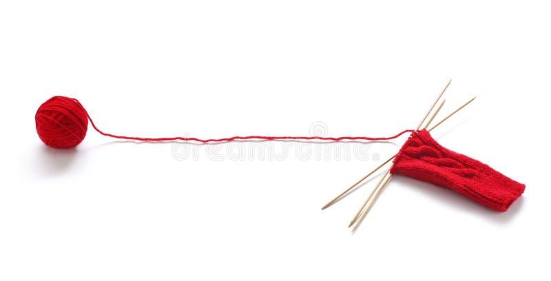球编织的面条红色纱线 免版税库存照片