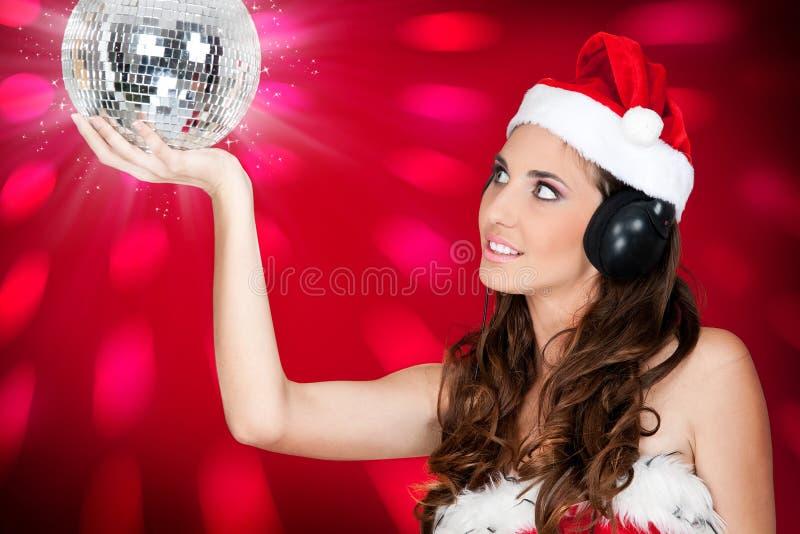 球迪斯科女孩帽子圣诞老人性感发光 免版税库存图片