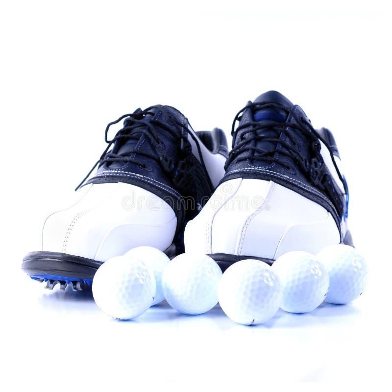 球高尔夫球鞋子 免版税图库摄影