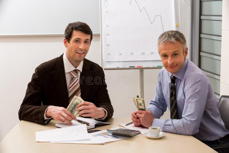 经理挣钱 免版税库存图片