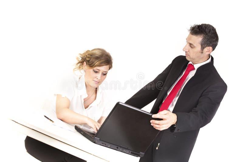 经理控制秘书 免版税库存图片