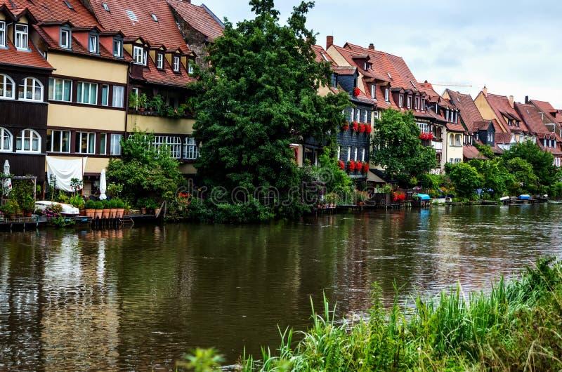 琥珀,雷格尼茨河,德国的银行的老fishermanÂ的房子 免版税库存图片