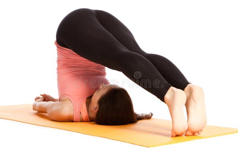 瑜伽姿势在演播室 免版税库存照片