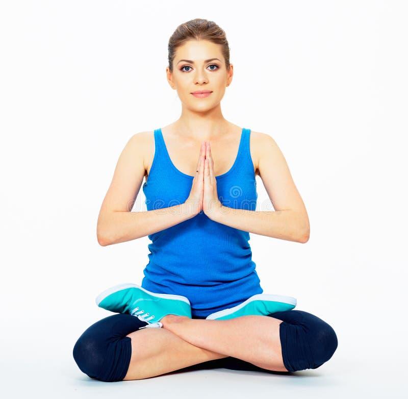 瑜伽姿势的少妇坐地板 库存照片