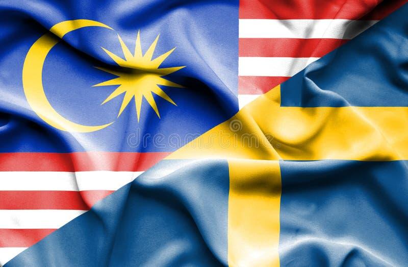 瑞典和马来西亚的挥动的旗子 库存例证