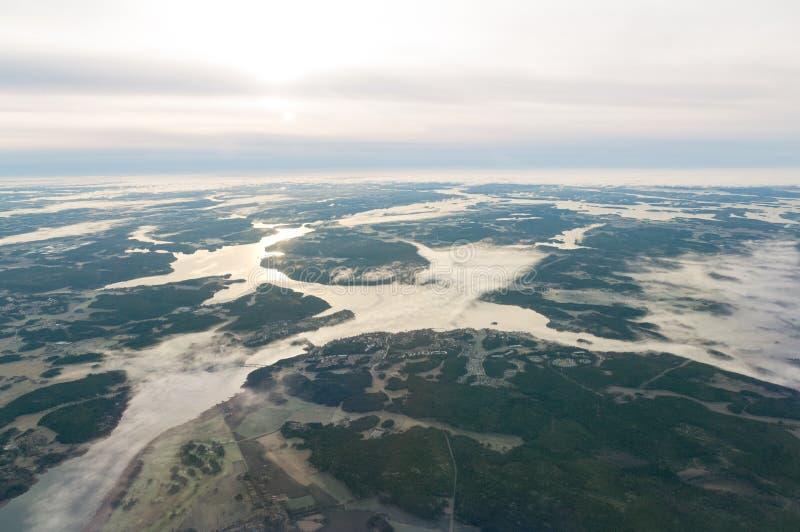 瑞典斯堪的纳维亚海岸寄生虫空中风景海日出 库存图片