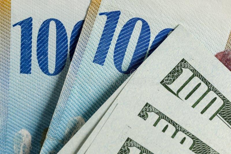 瑞士钞票和美元 免版税库存图片