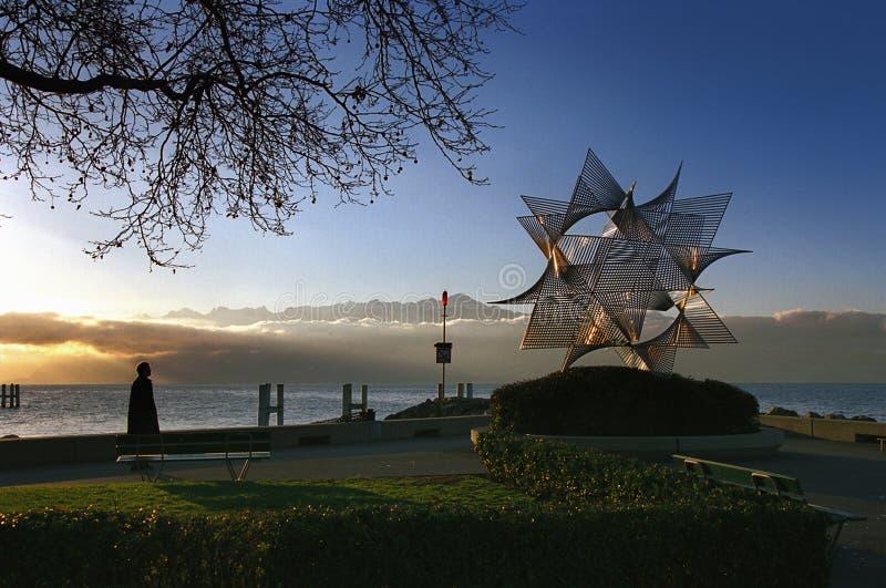 瑞士:日内瓦湖的洛桑Ouchy日落的 免版税库存图片