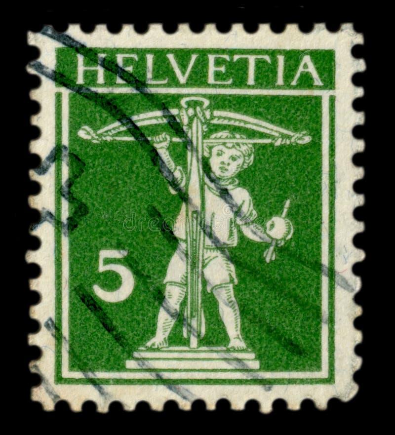 瑞士- 1914年11月13日:瑞士历史邮票:威廉的儿子告诉与石弓,与箭头,海尔维第邮戳的苹果计算机 免版税库存图片