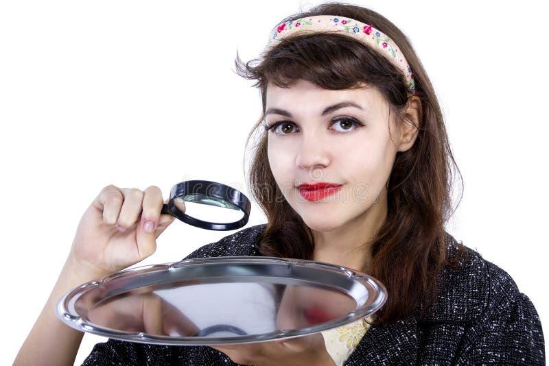 玻璃扩大化的妇女 免版税库存图片