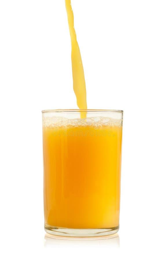 玻璃汁液橙色倾吐 库存图片
