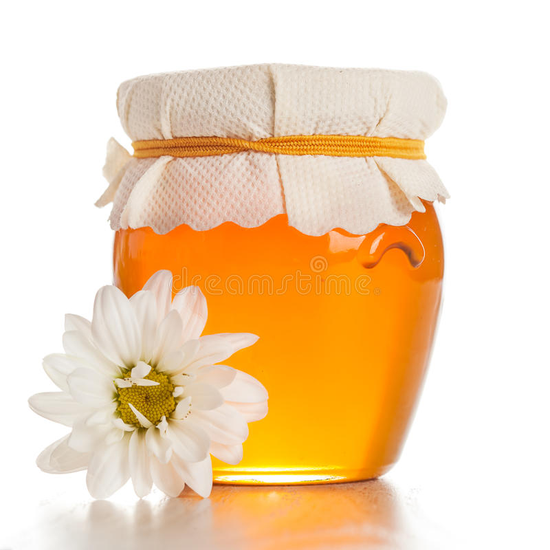 玻璃瓶子用蜂蜜 库存图片
