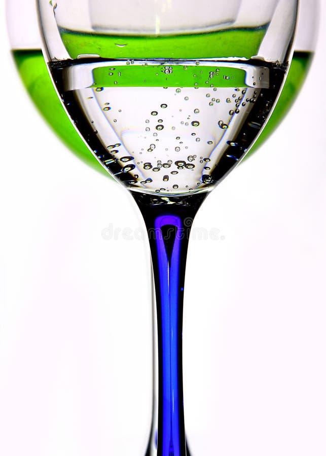 玻璃用利口酒和水 免版税库存照片