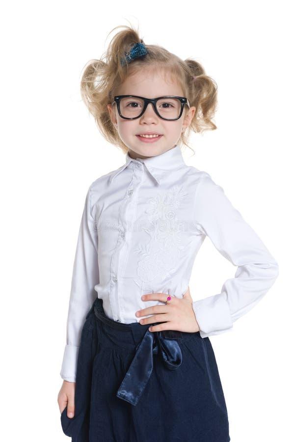 玻璃的愉快的小女孩 免版税库存图片