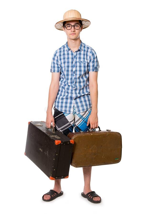 玻璃的年轻,英俊的人与准备好两个的袋子旅行 图库摄影
