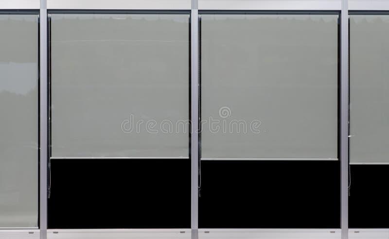 玻璃窗框架和塑料窗帘 免版税库存照片