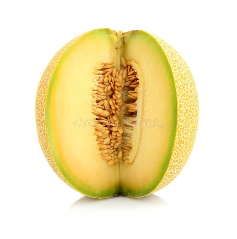 瓜galia刻凹痕与种子在演播室隔绝了白色 库存照片