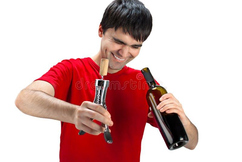 瓶人微笑的酒 库存照片