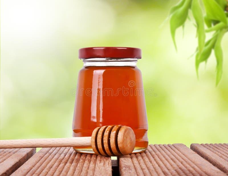瓶子与浸染工的蜂蜜 图库摄影