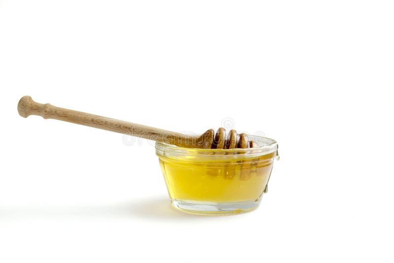 瓶子在白色背景的蜂蜜 免版税库存照片