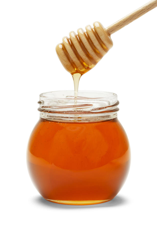 瓶子蜂蜜 免版税库存照片