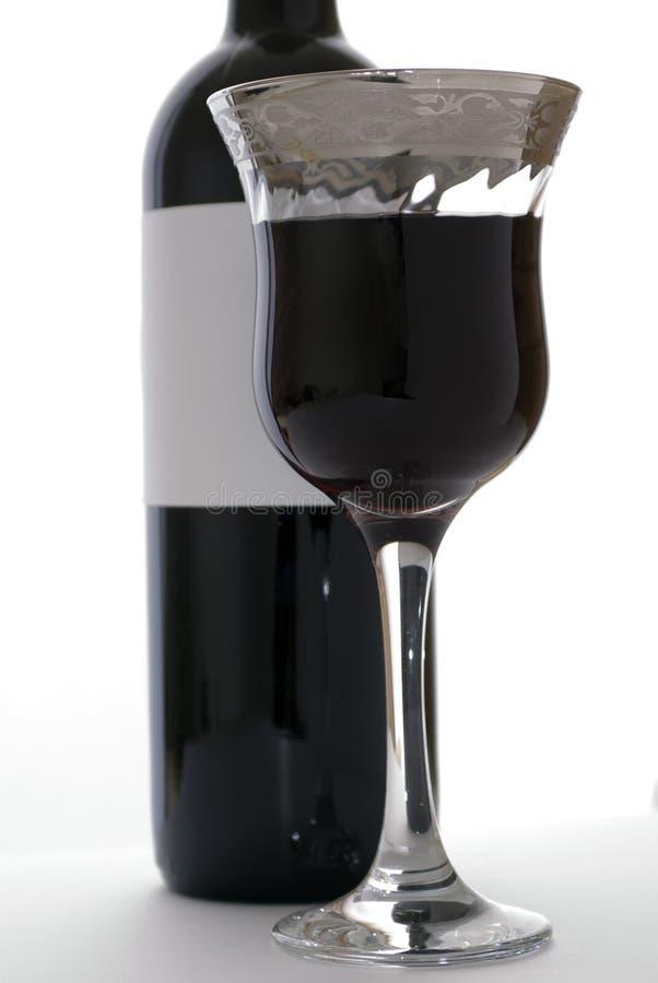 瓶花梢玻璃红葡萄酒 库存照片