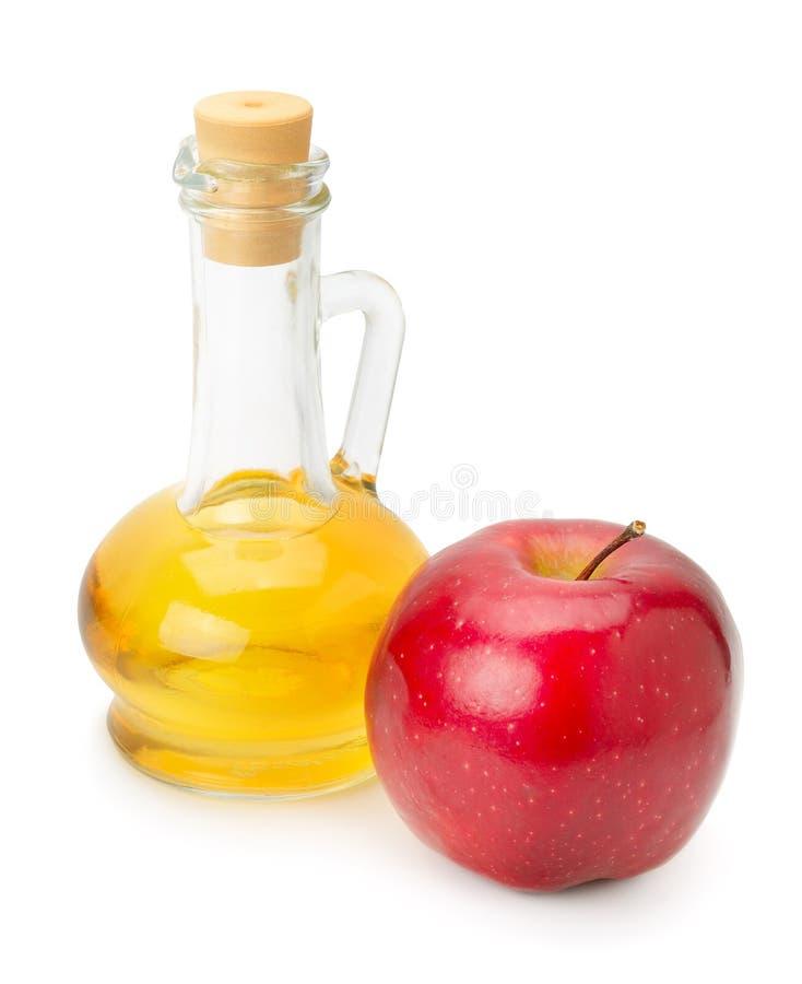 瓶苹果醋和苹果 免版税库存照片