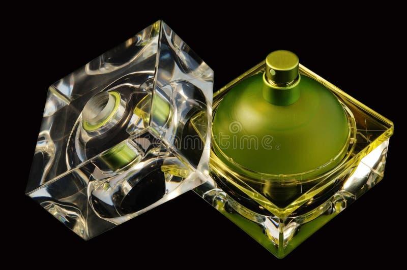 瓶被开张的香水 免版税库存照片